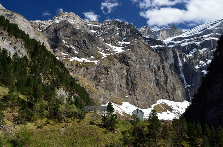 stratified: The cirque de Gavarnie is a large rock amphitheater. The cirques walls are twisted and layered. There are a lot of waterfalls and several peaks of over 3000m.