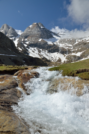 cirque: The mountain stream is rapidly flowing on the stone bed from the cirque of Troumouse.
