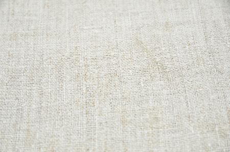homespun: Texture of the vintage homespun linen textile with selective focus