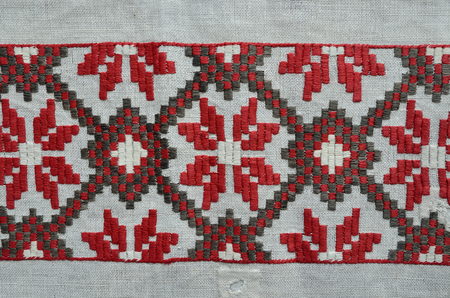 homespun: The geometric pattern is made by roll satin stitch on the homespun cloth. Stock Photo