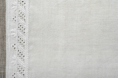 flaxen: The white homespun cloth is decorated with the handmade embroidery along the left side. It is made with the white thread by the flat stitch and openwork stitching.