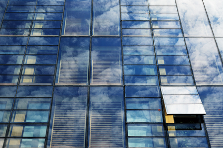 specular: Mirror surface of many equal parts is reflecting the blue sky with a white cloud Stock Photo