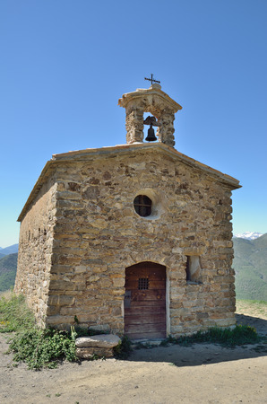 Small Roman Catholic church was built of rough stones in the XII century. Stock Photo