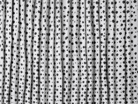 flaxen: The white-and-black polkadot homespun flaxen fabric is woven, printed and kilted manually.