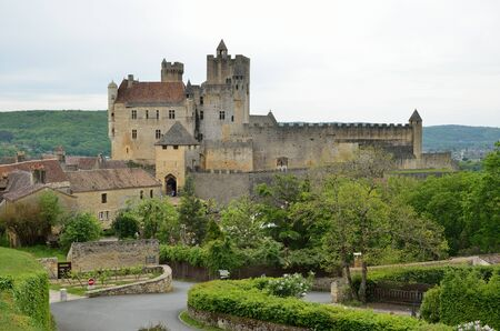 extant: The extant medieval castle is on the limestone cliff in the ancient French town Beynac-et-Cazenac.