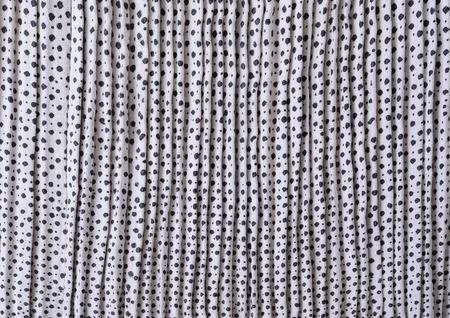 homespun: The white-and-black polkadot homespun flaxen fabric is woven, printed and kilted manually.