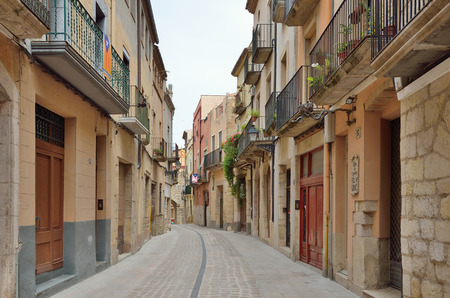 extant: The old-time street is in the historic quarter of the antique Spanish village Montblanc. The town is one of the best preserved in Catalonia.