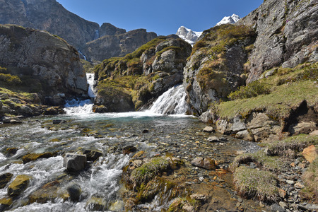 cirque: The mountain stream ruisseau du Cot is rapidly flowing on the plateau from the cirque of Troumouse. Stock Photo