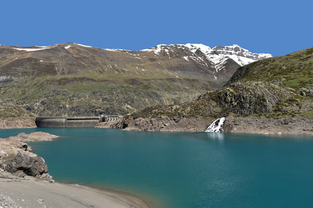 gave: An artificial lake is formed with the Gloriettes dam on the Gave dEstaube river in the Haute Pyrenees. Stock Photo
