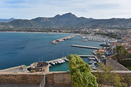 speedboats: Calvi is situated in the large sheltered bay. It is popular with visitors because it combines a historic town and a port. Stock Photo