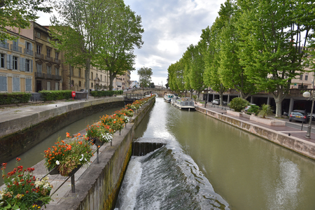 Ancient canal de la Robin runs through the center of the French city Narbonne.