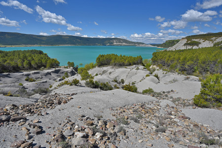Embalse de Yesa is a beautiful artificial reservoir on the border of Navarre and Aragon. There are opaque blue water and unusual geological formations of metamorphic rocks.