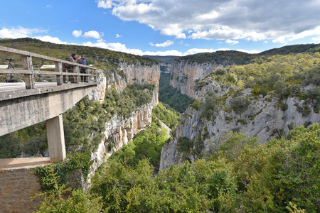 Arbaiun Gorge, Spain - May 01 2016: Several spectators are in the observation point above the deep fluvial gorge of Arbayun in the foothills of the Sierra de Leire. Editorial