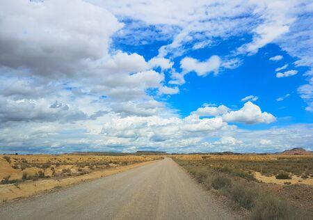 Gravel road across the Spanish desert Bardenas Reales in the southeast of Navarre