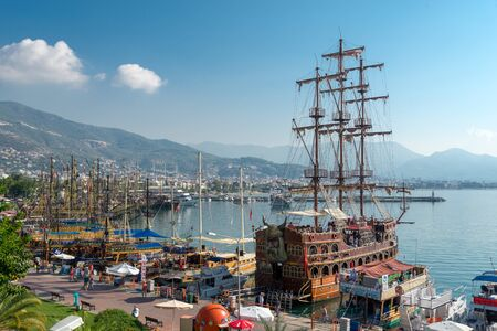 A big old-fashioned restourant in the shape of ship is moored in Turkish city Alanya