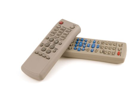 tv remotes: Two control stands on a white background, for a television set and for video. Stock Photo