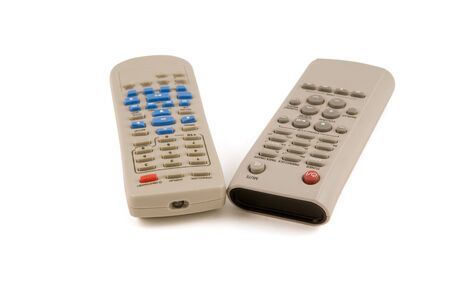 tv remotes: Two control stands on a white background, for a television set and for video