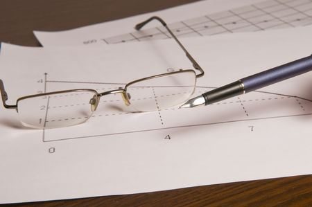 Pen and glasses on the graphic arts of sales Stock Photo - 4324857