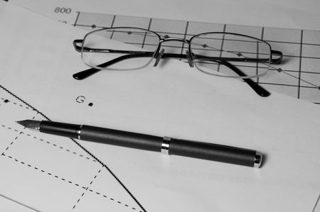 Pen and glasses on the graphic arts of sales  Stock Photo - 4324868