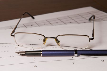 Pen and glasses   on the graphic arts of sales Stock Photo - 4324867