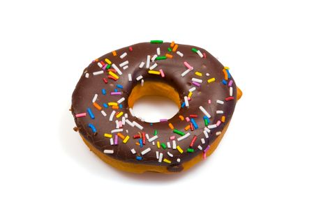 tempting: A tempting donut with chocolate icing and colorful sprinkles, isolated on a pure white background.