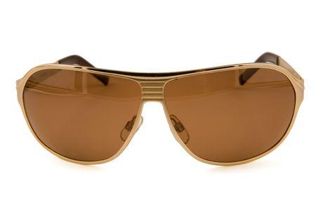 Fashion Sun glasses gold colour on a white background photo