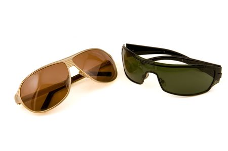 Fashion Sun glasses gold and black colour on a white background photo
