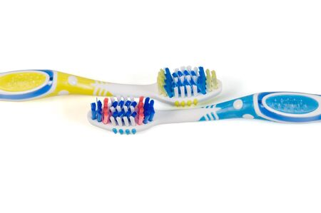 Two plastic tooth-brushes on a white background photo