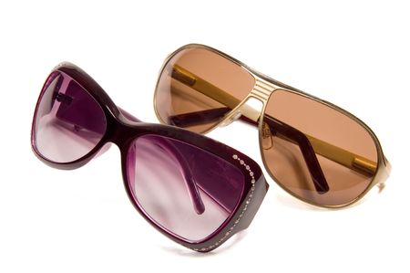 Purple and gold sun glasses on a white background