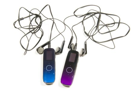 Two players MP3 of blue and purple colour with ear-phones on a white background photo
