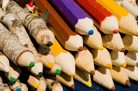 handwork: The big souvenir pencils from a natural tree of handwork Stock Photo