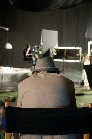 A producer looks  the shooting of musical video  clip Stock Photo - 4977771