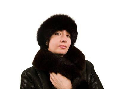 Mujer en un sombrero y cuello de piel es negro aislado sobre fondo blanco Foto de archivo - 5096306