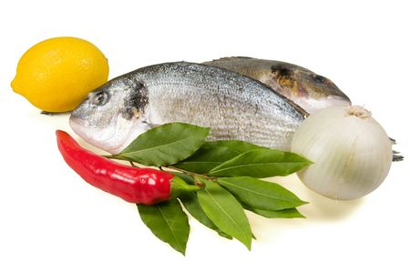 Fish (dorada) and vegetables separately on a white background. Stock Photo - 5564276
