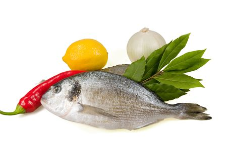 Fish (dorada) and vegetables separately on a white background. Stock Photo - 5564280