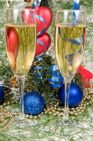 Christmas decoration assortment for holiday and two glasses of champagne photo