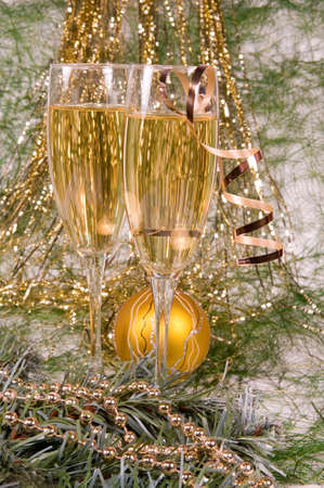 Glass of champagne against the Christmas ornament. photo