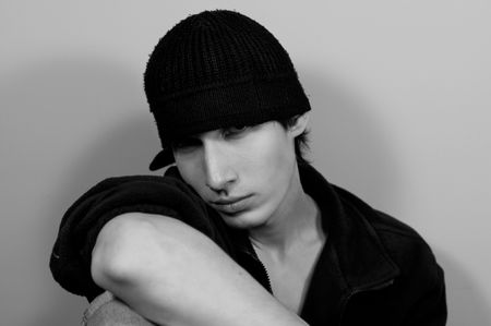 hoodlum: The young guy in a black knitted cap