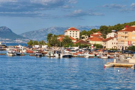 Croatia, Trogir. Boats and yachts stand at moorage, in the background mountains.