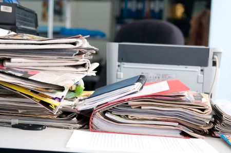 Heap of newspapers and the disorder on a table Stock Photo - 6796619