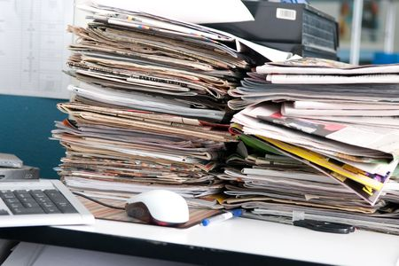 broadsheet: Heap of newspapers and the disorder on a desktop of the journalist Stock Photo
