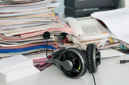 Headphones with a microphone and a mess on the table