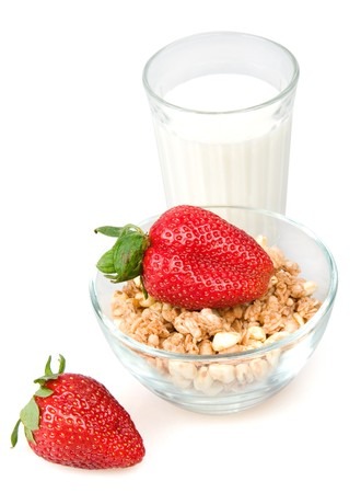 Muesli, milk and a strawberry is isolated on a white background photo
