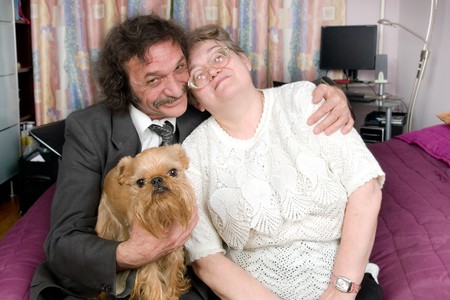 Happy family of older persons and the small doggie photo