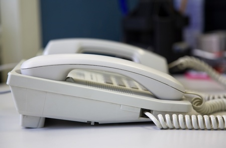 Two office phone on a gray desk Stock Photo - 9201059