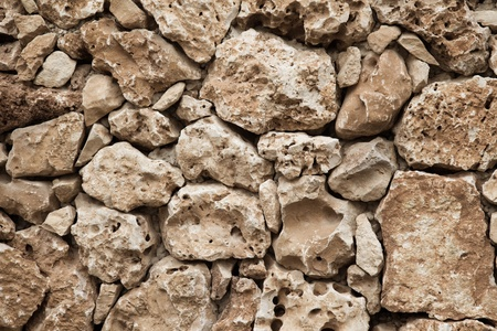 Detail shot of an old stone wall. photo
