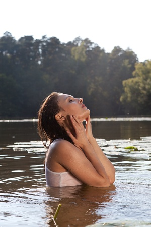 Beautiful young woman swim in the river Stock Photo - 10483269