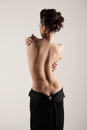 Beautiful silhouette of a woman with bare back photo