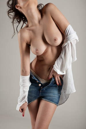 Beautiful woman with bare breasts in a white shirt Stock Photo