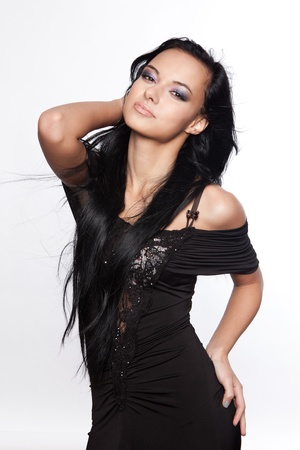 Beautiful young woman with black, long hair Stock Photo